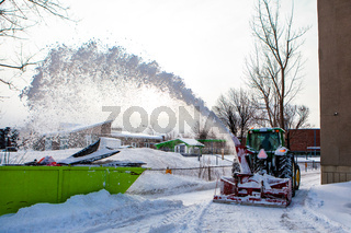 Snowblower tractor clearing snow