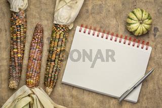 blank spiral art sketchbook with corn