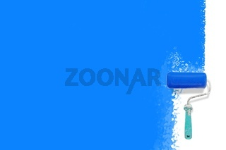roller brush with blue paint background  - Creative