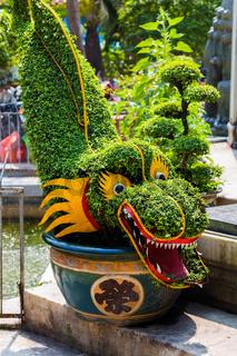 Oriental dragon statue grass figure in the park