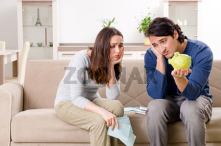 Young couple in budget planning concept